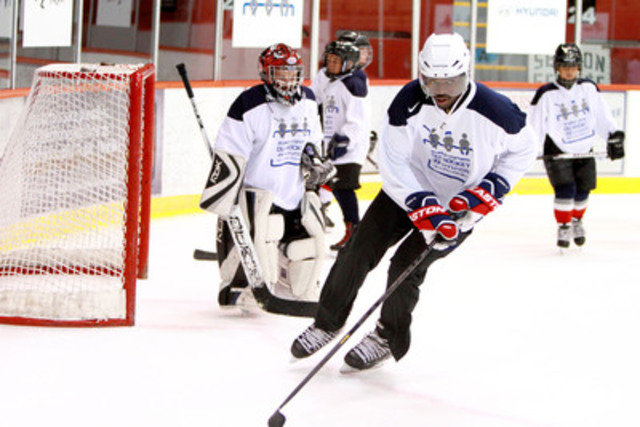 P.K. Subban demonstrates his hockey skills with kids at a rink in Verdun. Subban was in town to help launch Hyundai Hockey Helpers, a new program run by the automaker to help deserving kids afford the cost of equipment and league fees for organized hockey. (CNW Group/Hyundai Auto Canada Corp.)