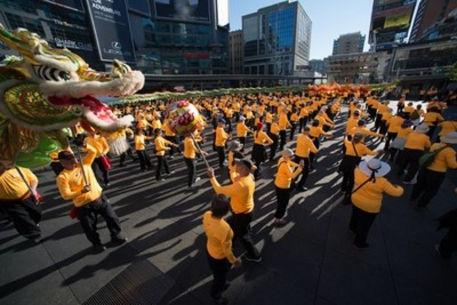 Yonge Dundas Square in Toronto will be filled with colourful and spectacular sights on Thursday August 11 as hundreds of people practice Taoist Tai Chi® arts together, huge dragons weave through the crowds and pipe and samba bands add to the entertainment. (CNW Group/Fung Loy Kok Institute of Taoism)