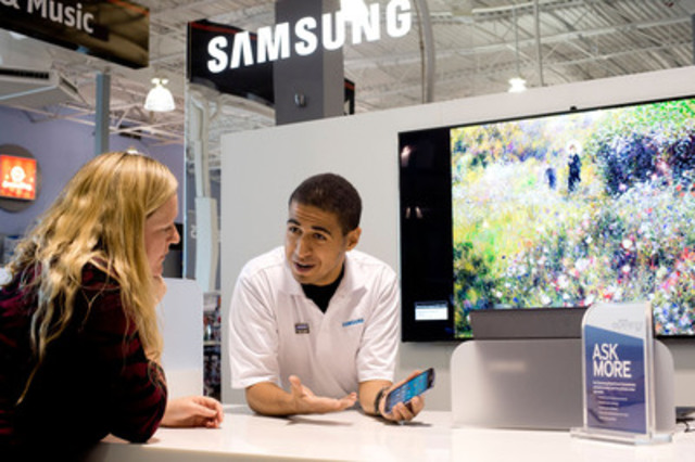 A Samsung Experience Consultant giving a product demo at the new Samsung Experience Shop at Heartland Town ...