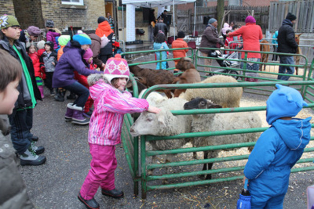 Kids celebrate Christmas in Toronto with furry friends like the ones available in The World Vision Gift Catalogue (CNW Group/World Vision Canada)