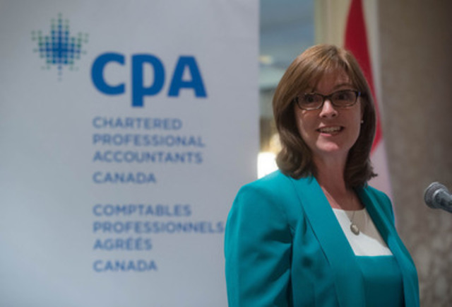 Jane Rooney, Canada's financial literacy leader, helps Chartered Professional Accountants of Canada celebrate its successful Community Connect outreach program Tuesday, March 24, 2015, in Vancouver.  The national program helps Canadians gain the knowledge and confidence required to make informed financial decisions. (CNW Group/CPA Canada)
