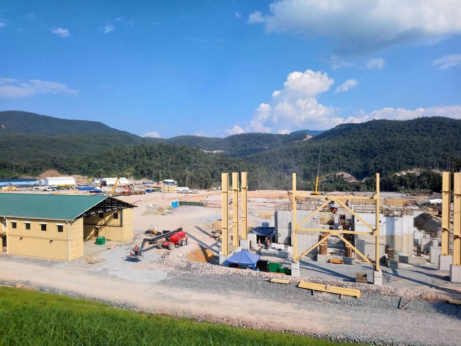 Figure 3. Grinding building steel erection is underway