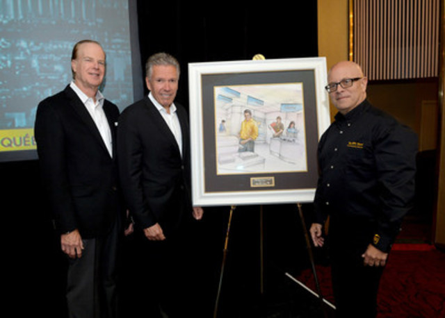 UPS Canada president, Michael Tierney (centre) presents a gift to Larry Plotnick, executive chairman, The UPS Store® (left) and David Druker, president, The UPS Store (right), to celebrate The UPS Store®'s 10th anniversary in Canada at The UPS Store convention in Montreal.  (CNW Group/UPS Canada Ltd.)