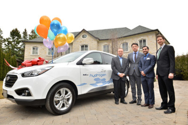 Joseph Cargnelli (left) takes delivery of the first zero-emissions, hydrogen-powered Hyundai Tucson Fuel Cell Electric Vehicle leased to a customer in Ontario. With him is (from l to r) Arthur Leung, General Manager at Don Valley North Hyundai, Ashkan Mavandadi, Sales Consultant at Don Valley North Hyundai, and Chad Heard, Senior Manager of Public Relations at Hyundai Auto Canada Corp. (CNW Group/Hyundai Auto Canada Corp.)