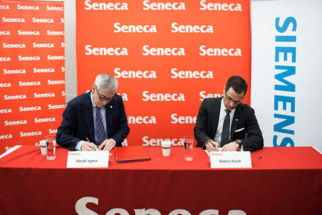 David Agnew, Seneca President (left) and Robert Hardt, President and CEO, Siemens Canada Limited (right) sign a memorandum of understanding at Seneca's Newnham Campus.  (CNW Group/Seneca College of Applied Arts and Technology)