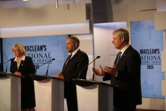 Elizabeth May, leader of the Green Party of Canada; Thomas Mulcair, leader of the New Democratic Party of Canada; and Stephen Harper, leader of the Conservative Party of Canada take part in the Maclean's National Leaders Debate at the City and OMNI Television studio. This was the first televised debate ahead of this year's federal election. (CNW Group/Maclean's)