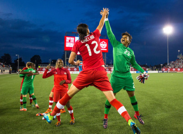 UNICEF Canada Ambassador and Canadian Women's National Team goalkeeper Karina LeBlanc and Canada's team captain Christine Sinclair high-five at the friendly game between Canada and England at Tim Hortons Field in Hamilton on May 29. ©CanadaSoccer / by Paul Giamou (CNW Group/UNICEF Canada)