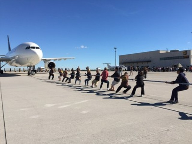 """On September 24, UPS Canada hosted a """"""""Pulling For U"""""""" event in support of United Way Burlington and Greater Hamilton raising more than $13,000. Teams of 15 came together to pull a 200,000 lbs. UPS Airbus 50 ft. across a tarmac in the shortest amount of time. UPS Canada has hosted four """"""""Pulling For U"""""""" events in 2016, Toronto, Vancouver, Calgary and Hamilton, raising more than $190,000 for United Way and helping build stronger communities across Canada. (CNW Group/UPS Canada Ltd.)"""
