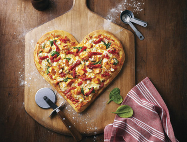 One dollar from every heart-shaped pizza sold at Boston Pizza on February 14 will support Boston Pizza Foundation Future Prospects which helps make futures bright by connecting kids with role models in their communities. (CNW Group/Boston Pizza International Inc.)