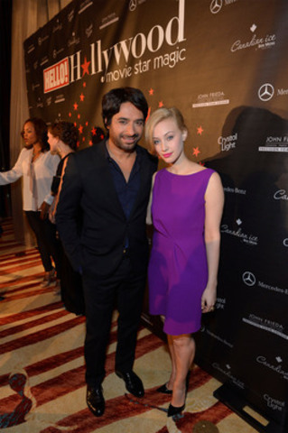 Hello TIFF Sept 8, 2012 LtoR: Jian Ghomeshi and Sarah Gadon HELLO! Canada welcomed a cast of celebrities and VIP guests to the Ritz-Carlton Toronto Saturday night for its annual Toronto Film Festival gala. The CBC Radio's Jian Ghomeshi and Canadian actress Sarah Gadon on the red carpet. (CNW Group/HELLO!)