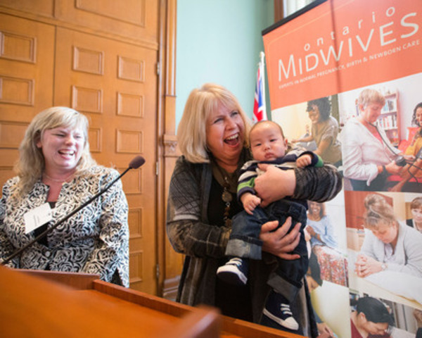 Minister of Health and Long-term Care Deb Matthews, right, holds three-month-old Hugh Kim as she stands next to Association of Ontario Midwives President Lisa Weston, left, before speaking at the association's educational exhibit at Queen's Park in Toronto on Wednesday, March 6, 2013. MPPs had the opportunity to learn about the quality care provided to women and babies in Ontario. (Photo by : Michelle Siu) (CNW Group/Association of Ontario Midwives)