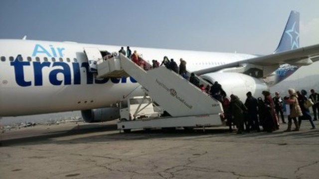 December 20, 2015 - 207 Syrian refugees left Amman this morning on an Air Transat Airbus A330, en route to Toronto. Air Transat is the first Canadian airline to participate in this large-scale humanitarian operation. (CNW Group/Transat A.T. Inc.)