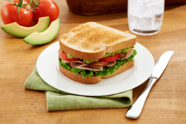 Turkey Club with Avocado Aioli - This zesty twist on the classic Turkey Club sandwich is a flavourful, healthier option that is sure to tantalize your taste buds and keep you healthy throughout the New Year. (CNW Group/Canada Bread)