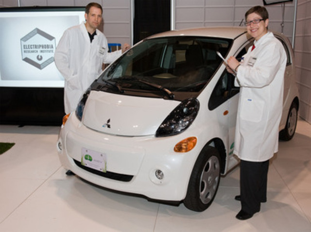 "Electriphobia Institute ""scientists"" Don Ulmer (L) and Keri Zierler clear the air on electric car misconceptions by placing Mitsubishi's pure electric i-MiEV hatchback front and centre at the 2012 Green Living Show in Toronto. ÊA unique approach to EV awareness, the fictitious ÒInstituteÓ pokes fun at misconceptions and clarifies the leading-edge technology that drives the 2012 i-MiEV. The Electriphobia web-based campaign debuts on April 16 on www.electriphobia.com. (CNW Group/Mitsubishi Motor Sales of Canada, Inc.)"