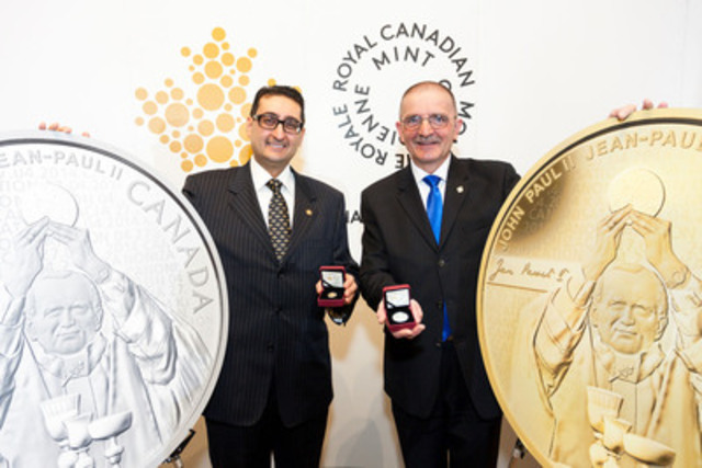 Simon Kamel, Acting Vice-President, Corporate and Legal Affairs from the Royal Canadian Mint and Wladyslaw Lizon, MP for Mississauga East-Cooksville unveil the gold and silver coins to commemorate the canonization of Pope John Paul II in Mississauga on March 27, 2014. (CNW Group/Royal Canadian Mint)