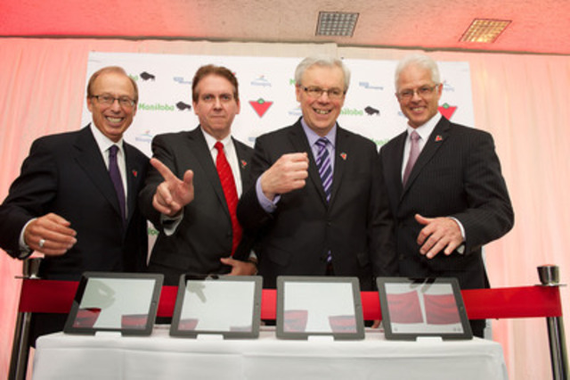 Canadian Tire Corporation opens 'Cloud Computing Centre' in Winnipeg, Manitoba. Pictured (L-R) Winnipeg Mayor Sam Katz; Eugene Roman, Chief Technology Officer, Canadian Tire Corporation; Premier Greg Selinger; Bill Morrissey, Leader, YES! Winnipeg. (CNW Group/CANADIAN TIRE CORPORATION, LIMITED)