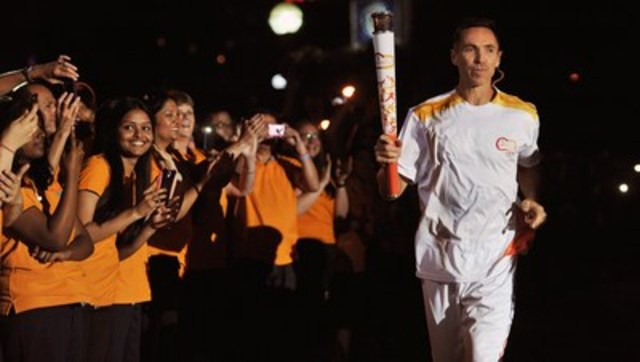 At the foot of the CN Tower in downtown Toronto, final TORONTO 2015 Pan Am Games torchbearer and retired NBA star Steve Nash dramatically ignites the Pan Am Games cauldron. (CNW Group/Toronto 2015 Pan/Parapan American Games)