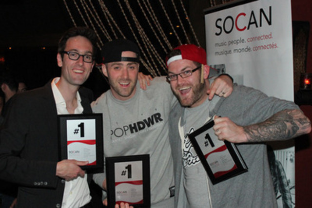 "David Myles (left), Classified (centre) and Michael Boyd (right) accept their SOCAN No. 1 Song Award plaques for the song ""Inner Ninja,"" which fought its way to the top of the charts in April 2013. (Photo: Jeff Knights) (CNW Group/SOCAN)"