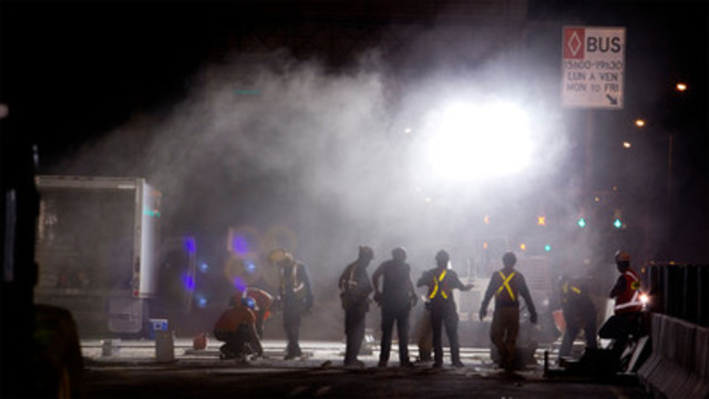 Workers in action during a night closure on the Champlain Bridge on the third weekend of the 2012 BLITZ. During these weekends, road work took place 24 hours a day, with several rotating shifts. (CNW Group/The Jacques Cartier and Champlain Bridges Incorporated)