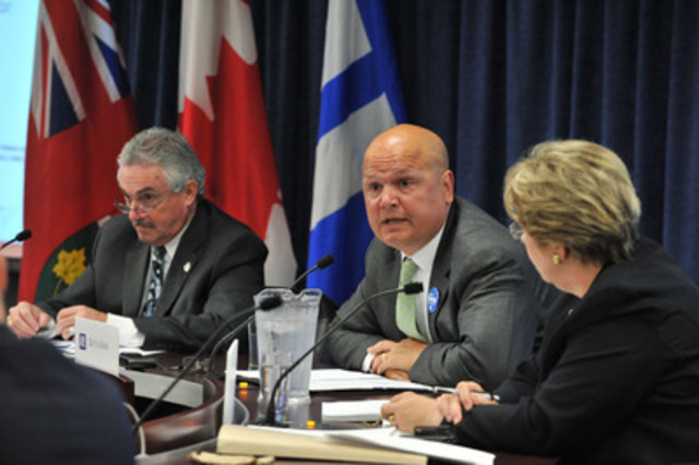 Eglinton - Lawrence PC candidate Rocco Rossi (centre) responds to questioner while Beaches - East York MPP Michael Prue (left) and Toronto Financial Services Alliance president Janet Ecker watch on. (CNW Group/Toronto Financial Services Alliance)