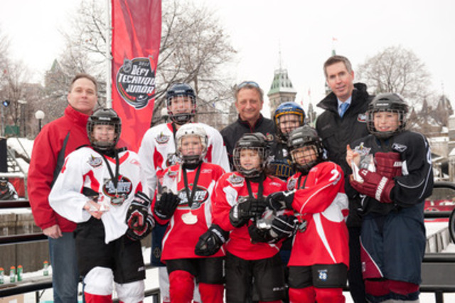 John Jobin, Vice President, Merchandising, Canadian Tire, Eugene Melnyk, Owner, Governor and Chairman of the Ottawa Senators and Brian Jennings, Executive Vice President, Marketing, NHL, present trophies to the seven Canadian Tire NHL Junior Skills(tm) National Champions on the Rideau Canal Skateway in Ottawa. (CNW Group/CANADIAN TIRE CORPORATION, LIMITED)