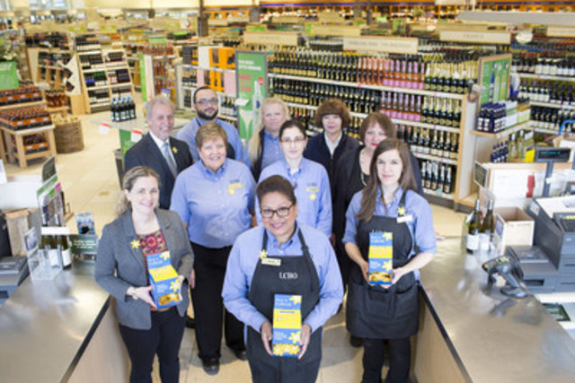 The team at the Dupont and Spadina LCBO store in Toronto join Susan Drodge (far left) of the Canadian Cancer Society to kick off Daffodil Month pin sales efforts at the LCBO''s more than 650 stores across Ontario. (CNW Group/Canadian Cancer Society (Ontario Division))