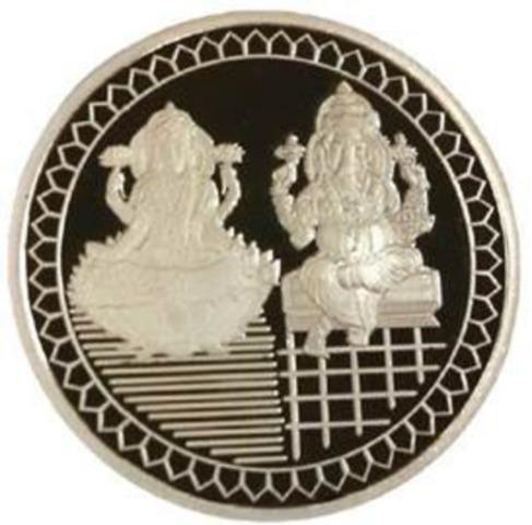 Les pièces Diwali, exclusivités de la Banque CIBC, sont disponibles en or et en argent. Elles représentent Lakshmî, la déesse de la chance, de la richesse et de la prospérité et Ganesha, le Dieu des commencements. Sur le revers de la pièce, se trouve le symbole Om. (Groupe CNW/Banque Canadienne Impériale de Commerce)