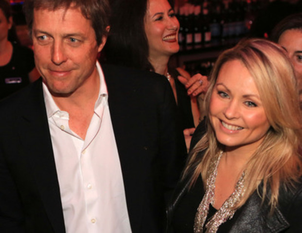 Actor Hugh Grant and Mitsou Gelinas at Hotel le St. James Ferrari reception, June 8, 2013. (CNW Group/HOTEL LE ST-JAMES MONTREAL)