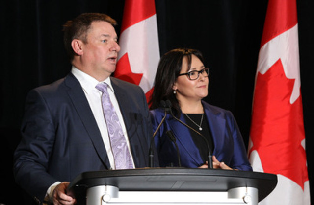 Michel Perron (left), Chief Executive Officer, Canadian Centre on Substance Abuse and National Advisory Council Co-Chair, is joined by Minister Aglukkaq (right) for the release of National Strategy First Do No Harm: Responding to Canada's Prescription Drug Crisis. (CNW Group/Canadian Centre on Substance Abuse)