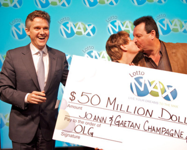 President and CEO of OLG Rod Phillips, left, presents Hawkesbury couple, Gaetan and JoAnn Champagne, with a cheque for $50 million at the OLG Prize Centre Wednesday. The Champagnes won the LOTTO MAX jackpot prize after purchasing a ticket for the December 30, 2011 draw. (CNW Group/OLG Winners)
