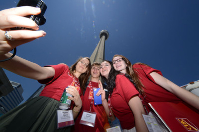 CIBC Youthvision scholarship winners and new friends pose for a photo in front of CN Tower in Toronto. Grade 10 scholarship winners from across Canada gathered in Toronto last week for a full-day inspirational event to celebrate the program's 15th year and over 450 lives changed since 1999. L to R: BC's Anna Maria (Masha) Baeva, Daniel Scheffer, Aziza Abdul Qader and Caitlyn Lyver from Ontario. (CNW Group/CIBC)