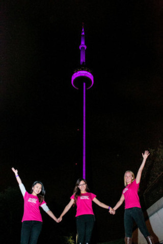 Plan Canada Because I am a Girl Youth Ambassadors Jennifer Dong, Crystal Gao, and Nicole Toole celebrate girls' rights in front of the CN Tower lit pink to mark the very first International Day of the Girl on October 11, 2012. Monuments across Canada will again be 'pinkified' on October 11, 2013. Photo courtesy of Plan Canada (CNW Group/Plan Canada)