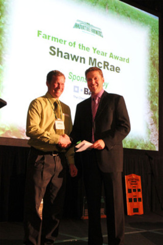 Bainsville farmer Shawn McRae is the Innovative Farmers Association of Ontario's 2012 Innovative Farmer of the Year. McRae was honoured for his innovative farming techniques at the organization's annual conference in London on February 28. McRae accepted the honour from BASF Canada's Trevor Latta during the event. (CNW Group/BASF Canada Inc.)
