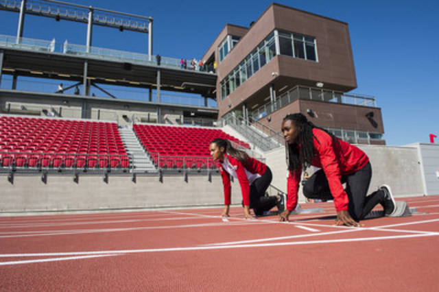 Khamica Bingham, TORONTO 2015 Pan Am Games bronze medallist, 4 x 100 m relay and Sheereen Harris, York University varsity track & field athlete take their marks at the handover event of the CIBC Pan Am/Parapan Am Athletics Stadium from the TORONTO 2015 Pan Am/Parapan Am Organizing Committee (TO2015) to the venue owner, York University. (CNW Group/Toronto 2015 Pan/Parapan American Games)