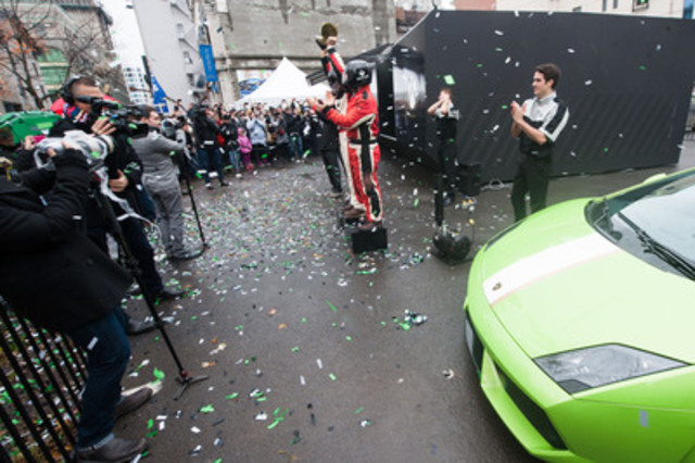 Performance race cars appear at colossal Xbox One to take fans for a ride at Gilles-Villeuneuve Circuit. The console appeared in downtown Montreal to celebrate the launch of Xbox One. The Xbox community unlocked the experience by pledging with their gamertags to the project known as One Source. (CNW Group/Microsoft)
