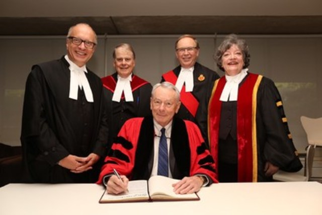 Richard W. Pound, C.C., O.Q., Q.C., (seated at centre) received an honorary Doctor of Laws, honoris causa, at the morning Call to the Bar ceremony in Toronto on June 21. Here, he signs the LLD Register with (l-r): Law Society CEO Robert G.W. Lapper, Q.C.; The Honourable Robert P. Armstrong, Q.C.; The Honourable Peter A. Daley, Regional Senior Judge, Central West Region, Superior Court of Justice; and Law Society Treasurer Janet E. Minor. Pound received the LLD in recognition of the profound impact his leadership and influence have had on integrity in sports. (CNW Group/The Law Society of Upper Canada)