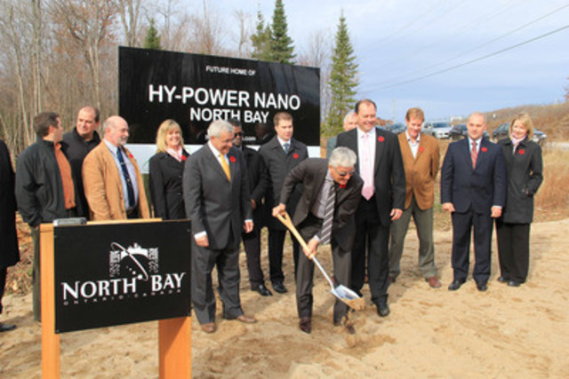 Joseph Grzyb, President and Founder of Hy-Power Nano (holding the shovel) breaks ground as Vic Fedeli, MPP Nipissing (left), and North Bay Mayor Al McDonald (right) watch during a ceremony held Nov. 8, 2011, in which Hy-Power Nano Inc. announced plans to establish a new research and production facility in North Bay, Ontario. Construction will commence in the spring 2012. (CNW Group/Hy-Power Nano Inc.)