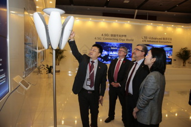Feridun Hamdullahpur,President and Vice-Chancellor and Stephen Watt, Dean of Math of the University of Waterloo tour Huawei's global operations headquarters in Shenzhen, China with Sean Yang, President Huawei Canada. (CNW Group/University of Waterloo)