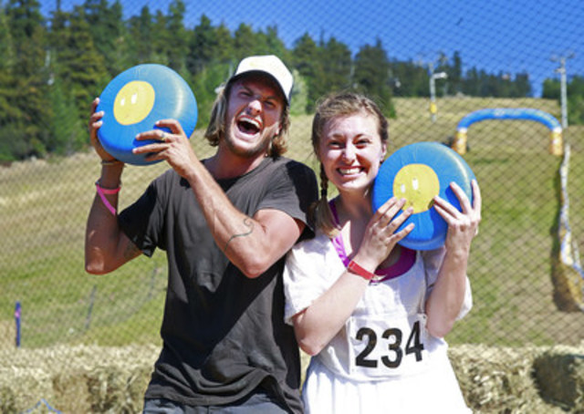 Mike MacDonald from Summerland, British Columbia and Laura Chipman from Bainbridge Island, Washington reigned supreme at the Great Canadian Cheese Rolling Festival in Whistler, British Columbia on Saturday, August 20, 2016. The two Grand Champions each went home with an 11-pound wheel of the delicious Canadian cheese and a pair of Whistler season's ski passes. (CNW Group/Dairy Farmers of Canada (DFC))