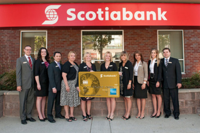 Just landed! Scotiabank employees at the Shaughnessy Station branch in Port Coquitlam, British Columbia celebrate the arrival of the new Scotiabank American Express® Cards - a suite of loyalty cards designed for travel enthusiasts. (CNW Group/Scotiabank - Products & Services)