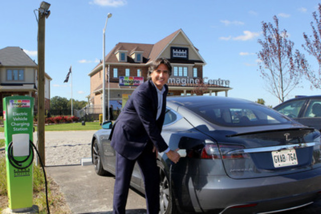 """""""Paul Golini Jr., EVP of Empire Communities charges a Tesla S using a KSI - GE DuraStation charger."""" http://www.empirecommunities.com/communities/imagine/ (CNW Group/Koben Systems Inc.)"""