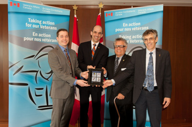 Steven Blaney, Minister of Veterans Affairs and Minister for La Francophonie (2nd from L) with Tim Laidler, Executive Director of the Veterans Transition Network, Dr. Blye Frank, UBC Dean of Education, and Dr. Michel Laurier, University of Ottawa Dean of Education, premier a new mobile app, PTSD Coach Canada. (CNW Group/Veterans Affairs Canada)