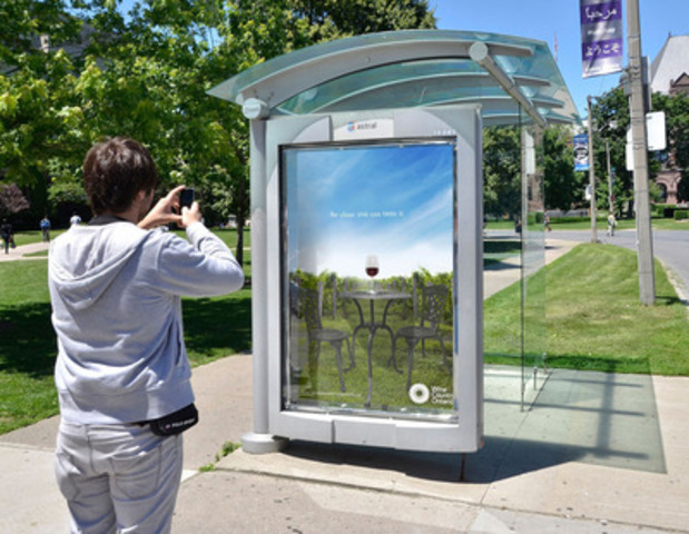 """""""Drink It All In"""" Stuntboard - Wine Country Ontario has placed an actual glass of wine in a transit shelter in downtown Toronto. (CNW Group/Wine Country Ontario)"""
