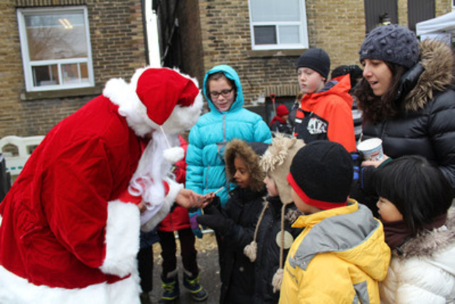 New Canadian children, along with local elementary students, meet Santa for the first time at a celebration of The World Vision Gift Catalogue at Christie Refugee Centre (CNW Group/World Vision Canada)