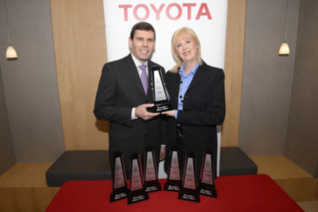 2015 Canadian Black Book Best Retained Value Awards: Larry Hutchinson, Vice President, Toyota Canada and Kathy Ward, Canadian Black Book  (CNW Group/Toyota Canada Inc.)