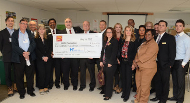 Mr. Larry Tomei, Senior Vice President, Retail and Business Banking for CIBC (6th from left) presents Dr. ...
