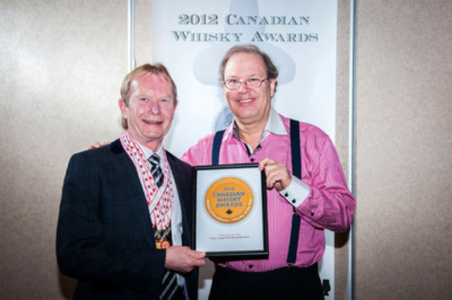 Whisky Maker, John K. Hall accepted the award for Canadian Whisky of the Year at the 2012 Canadian Whisky Awards in Victoria. Forty Creek Port Wood Reserve was selected from 60 entries by a panel of eight whisky experts. Left to right - John Hall, Davin de Kergommeaux. (CNW Group/Canadian Whisky Awards)