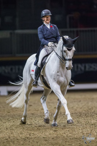 Jacqueline Brooks of Mount Albert, ON, riding her 2012 Olympic partner D Niro. Photo by Ben Radvanyi Photography (CNW Group/Royal Agricultural Winter Fair)