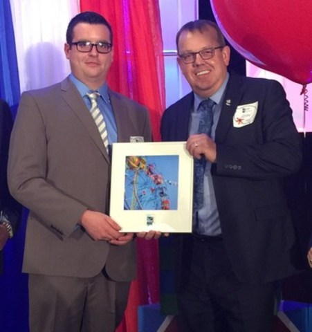 Allan Cramm, VP & General Manager, and Kyle Payne, Lab Technician, accepting the Best Places to Work in ...