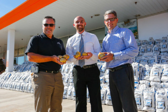Wayne Thompson, General Manager, Garden Isle Farms, John Lockhart, Atlantic Superstore District Manager and Greg Donald, PEI Potato Board, stand in front of a display of 140,000 pounds of PEI potatoes at the Charlottetown Superstore on September 22. All proceeds from the 20-pound bags of locally grown potatoes will go to President's Choice Children's Charity for grants to benefit childhood hunger programs on PEI. (CNW Group/President's Choice Children's Charity)